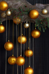 Christmas Balls and Spruce Branches with Cones on Natural Backgr