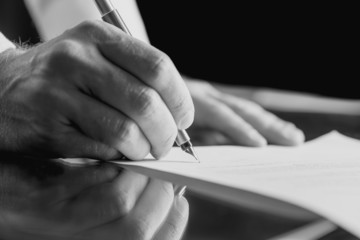 Businessman signing a business document