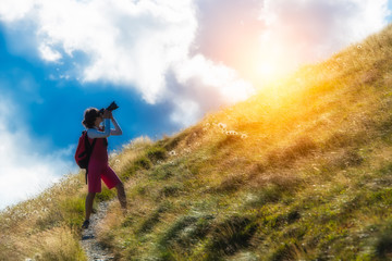 girl photographer in the mountains