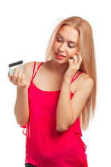 young woman doing online shopping while holding a credit card is