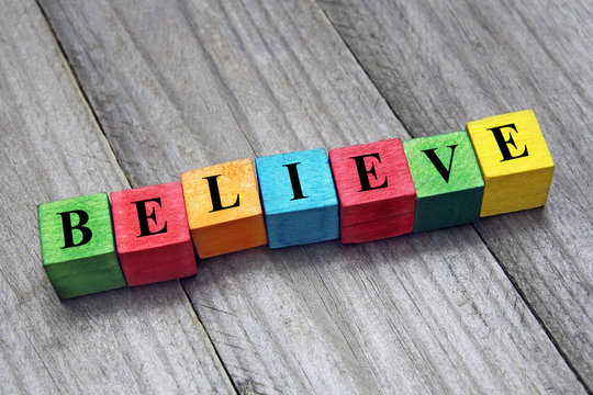 believe word on colorful wooden cubes