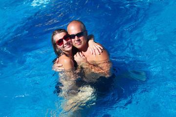 Loving couple in pool