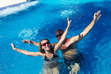 Happy couple in pool