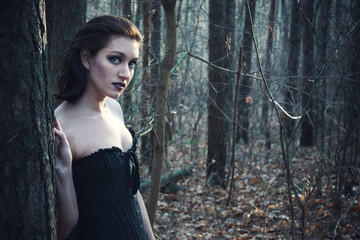 Gothic girl in a autumn forest