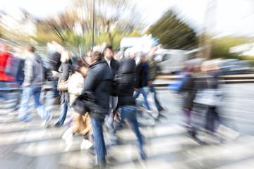 Pedestrians filling crosswalks in city