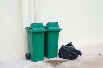 Green bin and Black garbage bags
