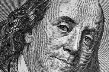 Benjamin Franklin's portrait on one hundred dollar bill.