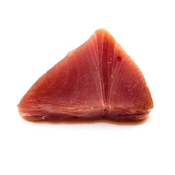 Yellowfin tuna steak isolated ona  white studio background.
