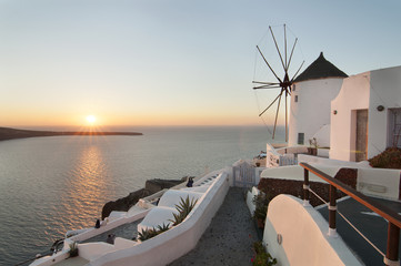 Santorini sunset from Oia village, with windmill.