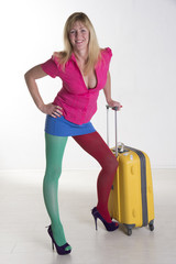 Woman wearing multicolored clothes and travel luggage
