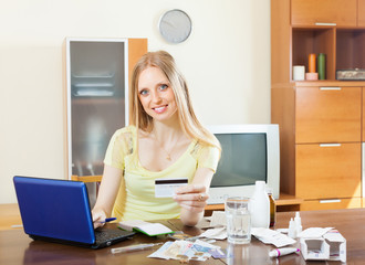 Woman paying medications in internet