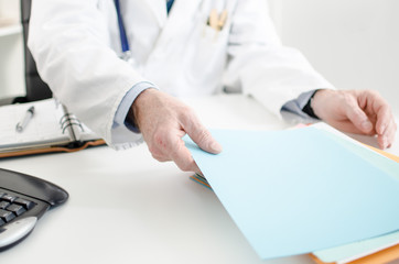 Doctor taking a file