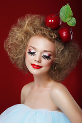 Grotesque. Humorous Woman with Red Apples and Fancy Makeup
