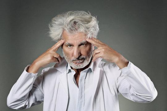 White hair scientist deeply focused