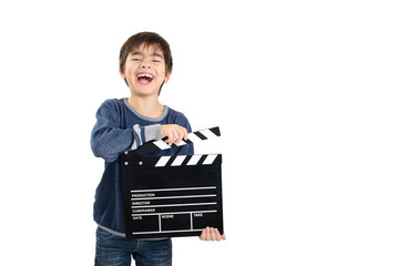 Laughing child holding clapperboard