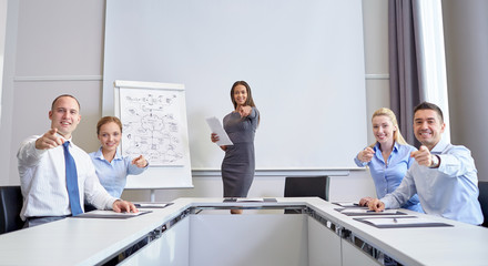 group of businesspeople pointing finger at you