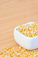 corn seeds in white bowl on table  for food concept