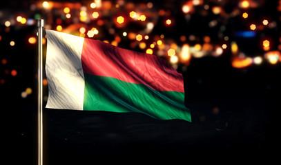 Madagascar National Flag City Light Night Bokeh Background 3D