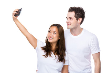 Caucasian man and chinese woman take selfie together