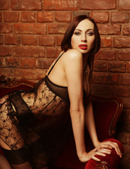 brunette wearing black lingerie posing on chair