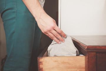 Man getting underwear from drawer