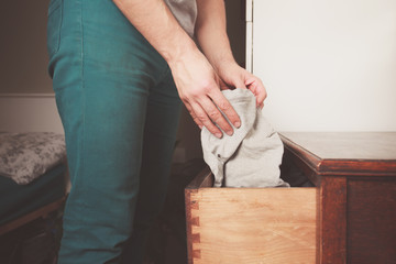 Man getting underwear from drawer