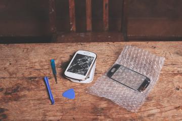 Broken smart phone and tools