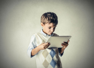 Little kid using a tablet