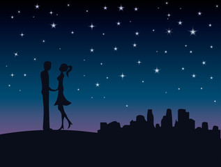 Silhouette of lovers couple under a starry sky