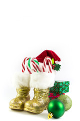 Santas golden boots and red hat with presents isolated