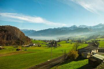 Green filed and lovely house in Switzerland