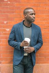 Portrait of Black Guy Holding Coffee