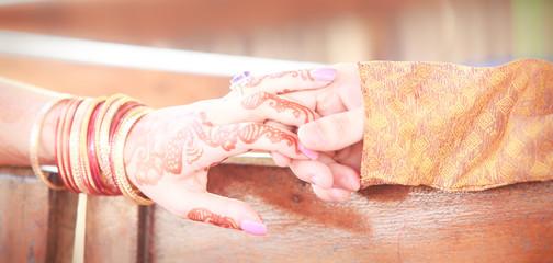 newlywed hands with mehendi