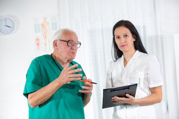 Old doctor and a nurse are consulted