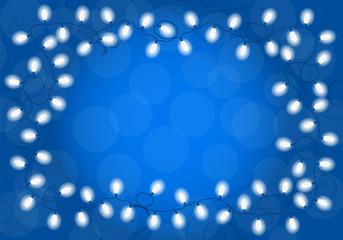 Lichterkette auf blauem Hintergrund mit Textfreiraum
