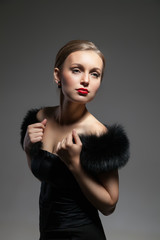 Young and beautiful woman in retro style with fur