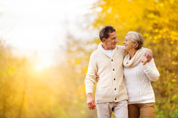 Active seniors walk in nature