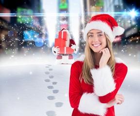 Composite image of pretty santa girl smiling at camera