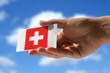 National flag of Switzerland over visiting card