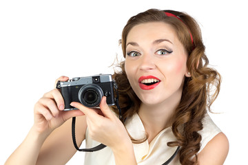 Image of the surprised woman with retro camera