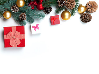 Christmas gift with pine branch on white background.