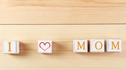 I love mom spelled in wooden blocks
