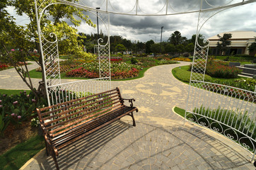 Bench in a garden with flowers and arbor - nice and neeat outdoo