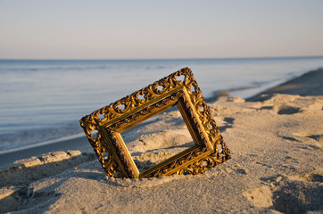 vintage golden picture frame on sea resort beach