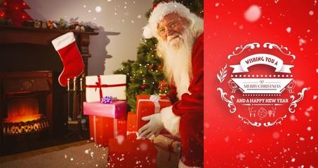 Smiling santa delivering gifts at christmas