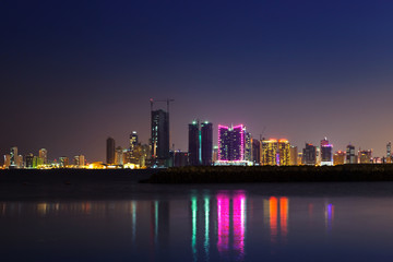 Night modern city skyline at night, Manama, Bahrain