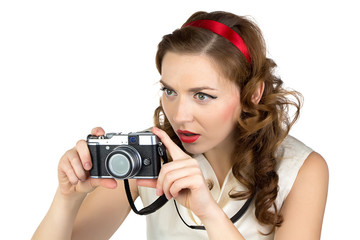 Portrait of the photographing woman with camera