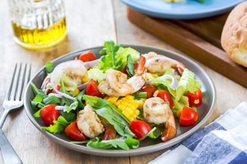 Prawns with sweet corn and rocket salad