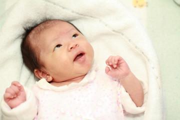 生後1ヶ月の赤ちゃんの笑顔