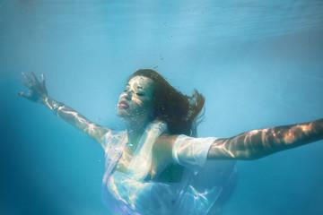 Foto op Plexiglas Zeemeermin underwater girl in swimming pool